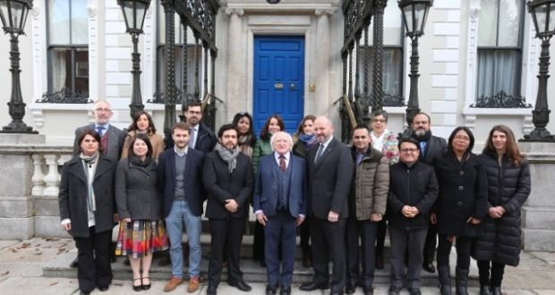 President Michael D Higgins with international activists and NGO representatives in Dublin at the launch of the Human Rights Defenders Memorial. Photograph: Conor McCabe
